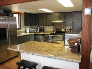 nice updated kitchen with stainless appliances and granite countertops