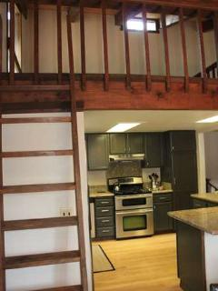 ladder to the loft above the kitchen - futon bed is here