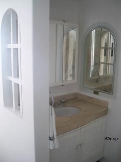 Ensuite vanity with original etching on mirror artwork titled 'The River of Life' by Ernesto, 2006