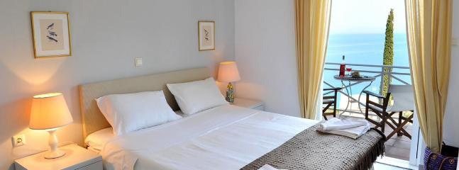 Charming double bedroom and amazing view over the Ionian Sea.