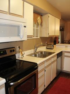 Fully stocked kitchen with new stainless steel appliances