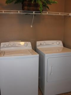 Full size washer and dryer in separate laundry room