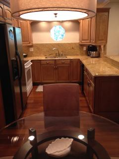 Beautiful Granite Counters and Maple Cupboards