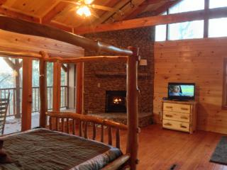 Master suite, stacked rock fire place, private deck, bath and sitting area.