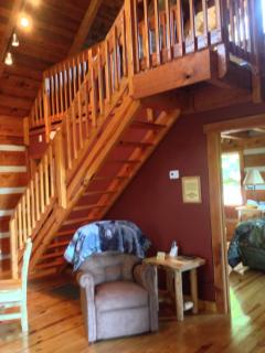 Up the stairs to the Spacious loft with Queen sized bed and soft for sitting!