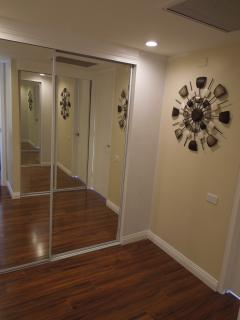 dressing room area w/one closet for your belongings and another filled w/beach gear for you to use