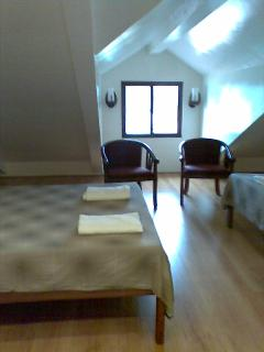 The attic bedroom has 4 double beds which can sleep 8 adults and 4 kids below 4 years old.