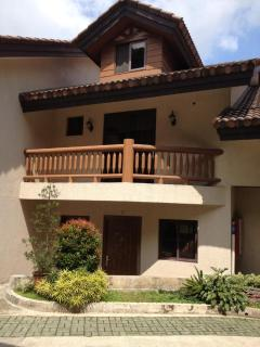 The main door of the town house is covered by the patio of the guest room.