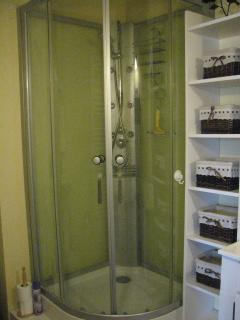 Shower and storage tower