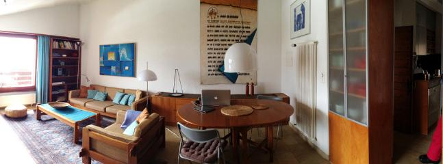 panoramic picture of living room with dining corner