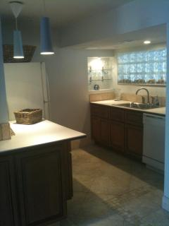 The Kitchenette of the Caban Room with Diishwasher , large basin sink  large Frig