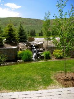 Chill out with a glass of wine on the patio; waterfall, stream, golf course views & Dollar ski area
