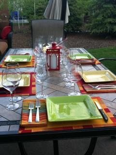 Enjoy outdoor dining & entertaining on a summer evening; nice large tile topped table & comfy chairs