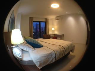 Spacious bedroom with table plus reading lamp for working