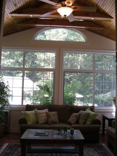 Sunroom has a fan and half round transom