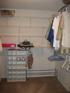 Master Walk-in-closet with shelves on 3 walls