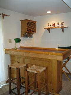 Bar with refrigerator and wine rack
