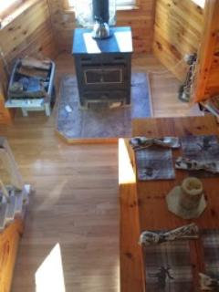 Looking down from loft dining room table and woodstove