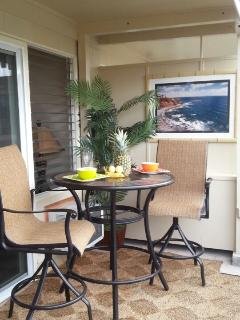 Bistro Table on Lanai with hawaiian art and grass mat flooring