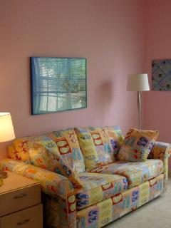 Pink bedroom has desk, dresser