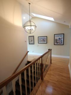 Hallway (upstairs) with high ceiling and hardwood floor