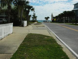 The beach is that close!  This photo was taken from the driveway of the home and NOT zoomed in.
