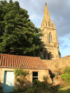 Back garden with views of church