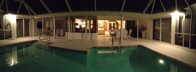 sitting by the pool at night with the fountain on the lake doesn't get better than this