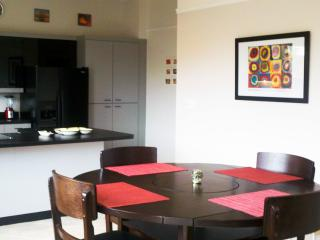 Dining area with view of kitchen