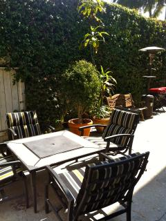Backyard with fire pit  table, chairs and propane heater (you refill)