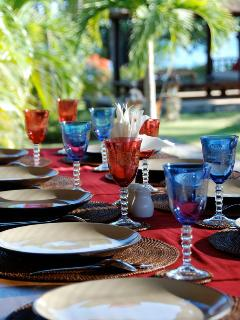 Served outdoor dining table prepared by staffs.