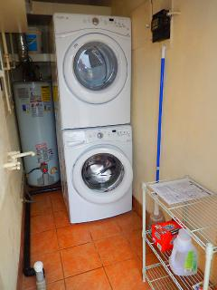 Additional utility room with washer and dryer