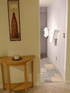 Hallway decor leads to bathroom.