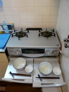Useful table under gas stove!