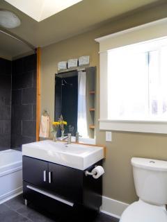 Top floor bathroom has rain shower and heated floor.