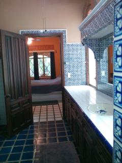 Beautifully tiled bathroom with oversize shower, well stocked with sheets, bath towels, pool towels, extra pillows