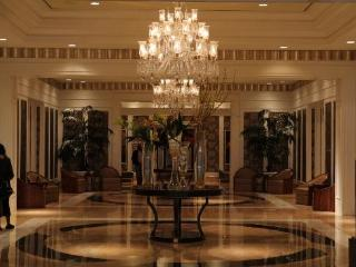 An elegant hallway to the elevators.