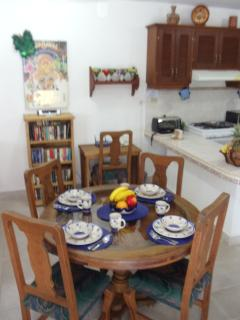 The dining area. Set for 4, but there are 6 chairs to use