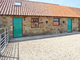 COW BYRE COTTAGE, feature beams, lawned garden with furniture, close to coast