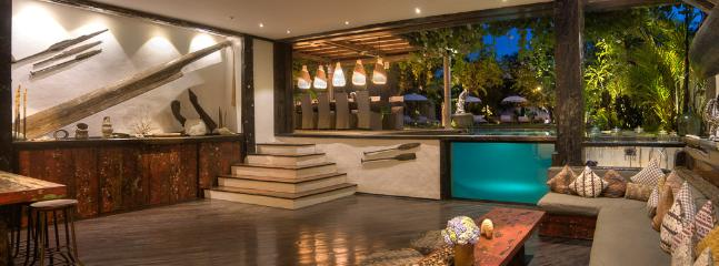 Sunken living room view into pool and dining area