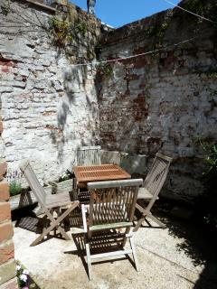 The sunny rear courtyard - perfect for an evening glass of wine!