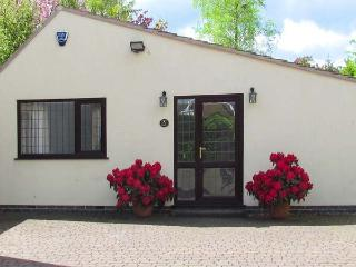 MILLERS RETREAT, pet friendly, country holiday cottage, with a garden in