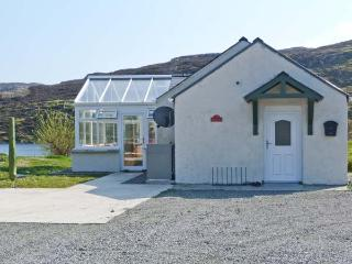 OLD MISSION HALL, pets welcome, woodburner, loch views, romantic retreat, near Cromore on Isle of Lewis, Ref. 14263