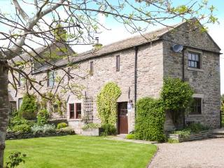 WHITBRIDGE COTTAGE, stone-built, en-suite, woodburning stove, off road parking