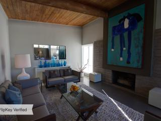 Designer decorated  living room with Mascot painting  of 'Lou-the Blue Horse'.