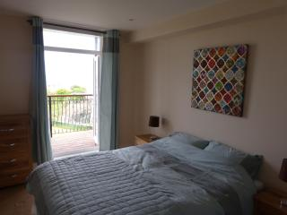 Master Bedroom - Access to balcony and views across Towan Beach and the Island