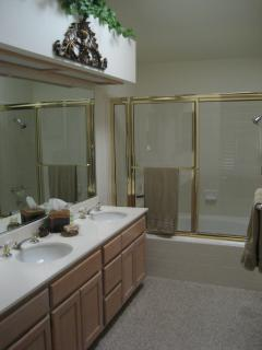 Master Bathroom with Dual Sinks, Shower/Tub, private toilet & walk in closet