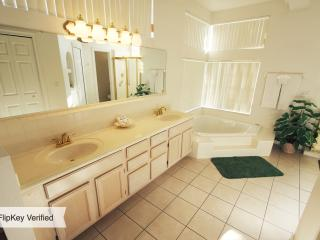 Master bath with  a garden-tub , double vanity , separate stall shower