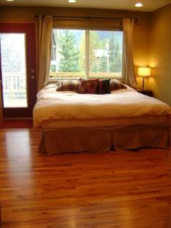 Bedroom with king bed off of large deck