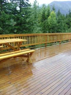 Double doors lead to Extra-large 774 square-foot deck